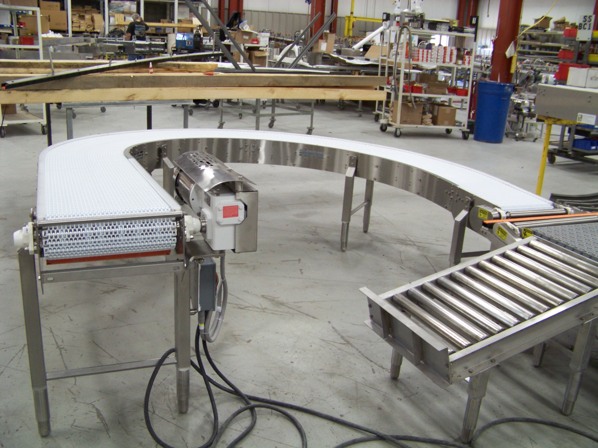 Powered belt curve conveyors patois associates Motorized conveyor belt